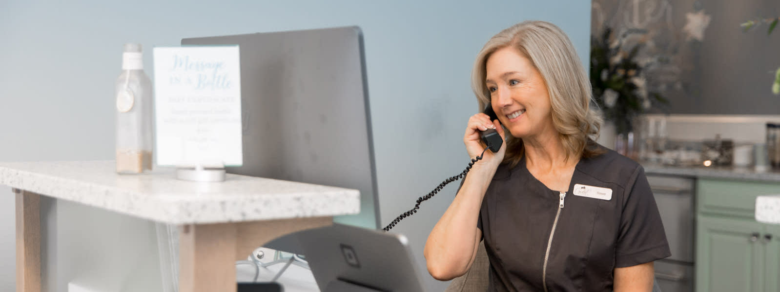 spa receptionist on the phone